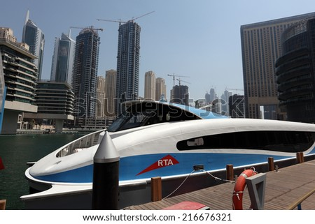 DUBAI MARINA, UAE - MAY 28: Modern ferry boat in Dubai Marina. May 28, 2011 in Dubai, United Arab Emirates  - stock photo