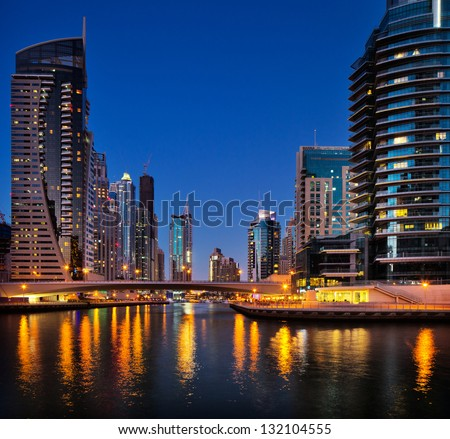 DUBAI MARINA, UAE - OCT 2: A night view of Jumeirah Beach Residence Towers on Oct 2, 2012 in Dubai, UAE. Dubai Marina is an artificial 3 km canal carved along the Persian Gulf shoreline