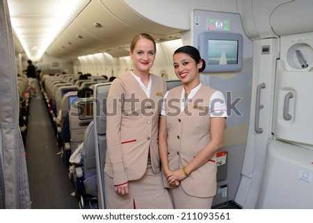 DUBAI - MAY 16: Emirates crew members in Airbus A380 aircraft on May 16, 2014 in Dubai, UAE. Emirates handles major part of passenger traffic and aircraft movements at the airport. - stock photo