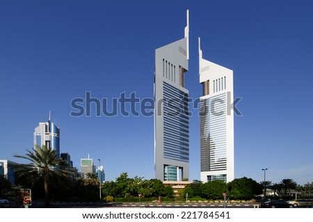 DUBAI - MAY 11: Emirates Towers at night time, 11 May 2014 in Dubai, UAE. Jumeirah Emirates Towers, Dubai's finest city hotel, is located in commercial business district.  - stock photo