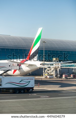 DUBAI - NOV 23: An Emirates plane is parked on November 23, 2015. Dubai airport's traffic is very heavy in the mornings as can be see here planes are queuing up for departure
