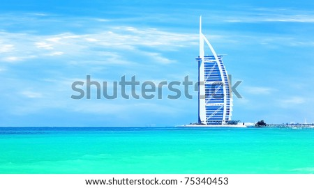 DUBAI - NOV 21: Burj Al Arab - at 321m second tallest hotel in the world, luxury hotel stands on artificial island, Nov. 21, 2009 Jumeirah beach, Dubai, United Arab Emirates - stock photo
