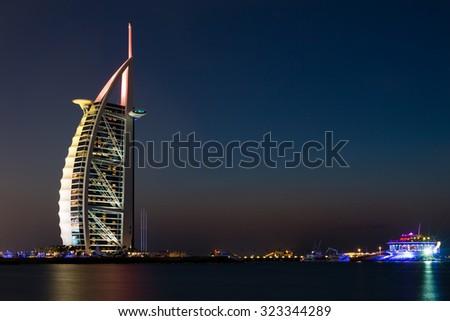 DUBAI - NOVEMBER 16: Burj Al Arab the luxury seven star Dubai hotel at sunset on November 16, 2014 in Dubai - stock photo