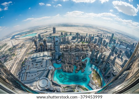 DUBAI - NOVEMBER 22, 2015: Dubai skyscrapers on a sunny day. The city attracts millions of visitors worldwide every year.
