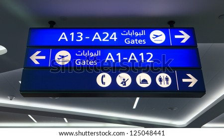 DUBAI - NOVEMBER 18: Notice board at Dubai airport on November 18, 2012 in Dubai, UAE. The airport is major aviation hub in the Middle East with max throughput of 80 mln passengers per year - stock photo