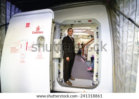 DUBAI - OCT 17: Emirates crew member meet passengers in Airbus A380 aircraft on October 17, 2014 in Dubai, UAE. Emirates handles major part of passenger traffic and aircraft movements at the airport. - stock photo