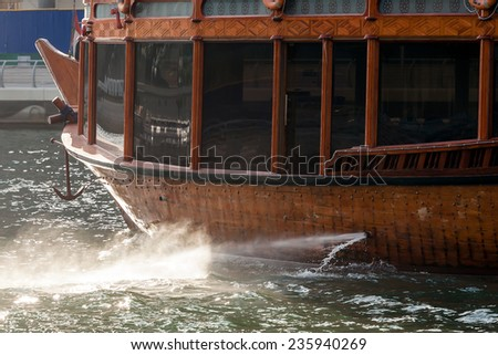DUBAI - OCTOBER 11: A Dhow going through a river in Dubai Marina as seen on 11 October 2014.  - stock photo