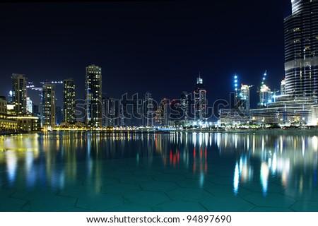 Dubai´s buildings at night. - stock photo