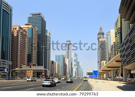 DUBAI - SEP 01: Dubai skyscrapers on Sheikh Zayed Road on September 01, 2010 in Dubai. The highway runs parallel to the coastline to the border with Abu Dhabi. It is home to most of Dubai skyscrapers - stock photo