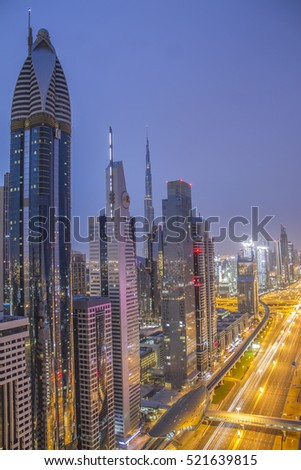 DUBAI, SHEIKH ZAYED ROAD - JAN 27th, 2016 ; Beautiful Cityscape view with enlightened road traffic with cityscape