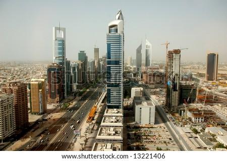 Dubai skyline along the Sheikh Zayed Road - stock photo