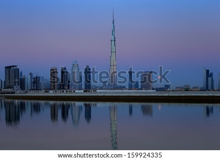 Dubai skyline at dusk seen from the Gulf Coast, shows the Sky Scrapers of the Sheikh Zayed Road - stock photo