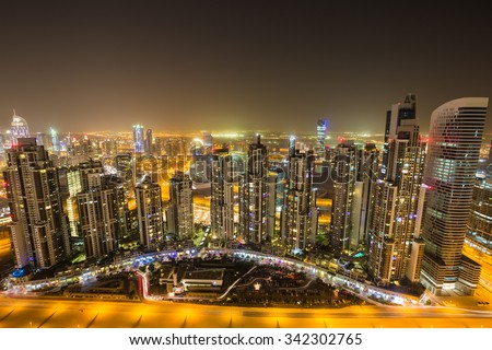 Dubai skyline.Dubai Downtown.Dubai by night.Dubai rooftop view.Dubai skyscrapers.Dubai best view.Dubai homes.Dubai Business bay.Dubai iconic view.Dubai panorama.Dubai cityscape.Executive towers - stock photo