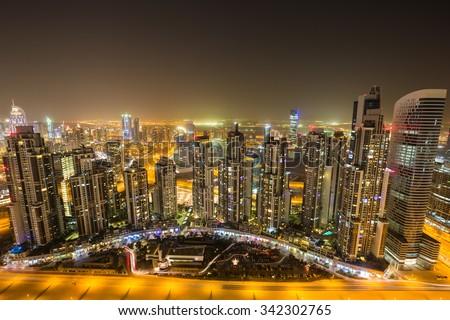 Dubai skyline, skyscrapers, cityscape. Executive towers. Dubai Downtown. Dubai Business bay views. Dubai from above. Night skyline. City lights. Dubai evening. Futuristic city. Rooftop view. UAE. - stock photo