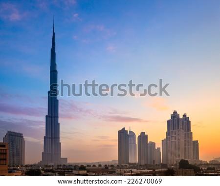 Dubai skyline with Burj Khaleefa the tallest building over the horizon. - stock photo