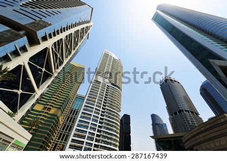 Dubai skyscrapers rising into the sky. - stock photo