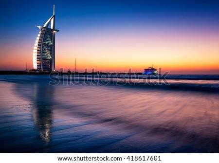 DUBAI, UAE - APR 14, 2013: Famous Jumeirah beach view with 7 star hotel Burj Al Arab, Dubai, United Arab Emirates - stock photo