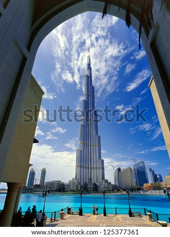 DUBAI, UAE - APRIL 17 - Burj Khalifa, the tallest building in the world stands at 829.8 m tall. The people viewing give an indication of the scale. Picture taken on April 17, 2010. - stock photo