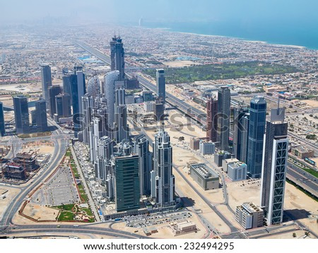 DUBAI, UAE - APRIL 27: Downtown Burj Dubai April 27, 2014 in Dubai, United Arab Emirates. Dubai is biggest city of UAE and one of the most important financial centers of the Middle East economy - stock photo
