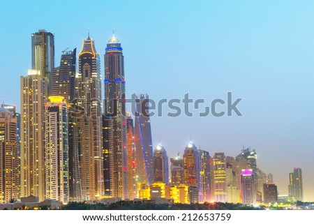 DUBAI, UAE - 2 APRIL 2014: Downtown of Dubai at dusk, UAE. Dubai is the most populous city in the United Arab Emirates with 2,1 million people. - stock photo