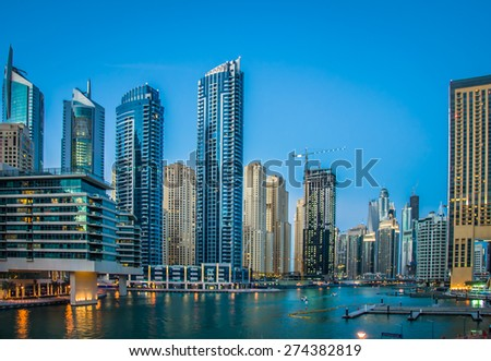 DUBAI, UAE - April 3: Dubai Marina at Dusk Dubai, UAE. In the city of artificial channel length of 3 kilometers along the Persian Gulf.Shot taken on April 3rd, 2015