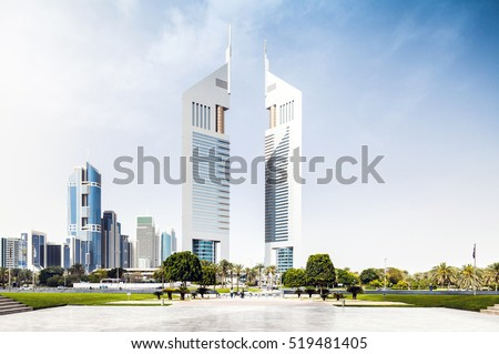 DUBAI, UAE - APRIL 27, 2016: Emirates Office Tower along with Jumeirah Emirates Towers Hotel in Dubai. View from the plaza