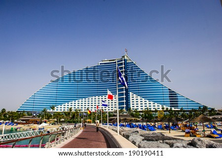 DUBAI, UAE - APRIL 09: Jumeirah Beach Hotel on April 09, 2014 in Dubai, UAE. Well-known for its wave-shaped silhouette, remains one of the best recognizable landmarks of Dubai, UAE  - stock photo