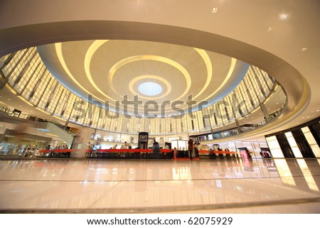 DUBAI, UAE - APRIL 14: Shoppers at Dubai Mall April 14, 2010 in Dubai, United Arab Emirates. Dubai Mall is one of the largest mall in the world. - stock photo