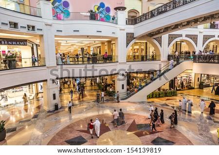 DUBAI, UAE - APRIL 29: Shoppers at Mall of the Emirates on April 29, 2013 in Dubai. Mall of the Emirates is a shopping mall in the Al Barsha district of Dubai. - stock photo
