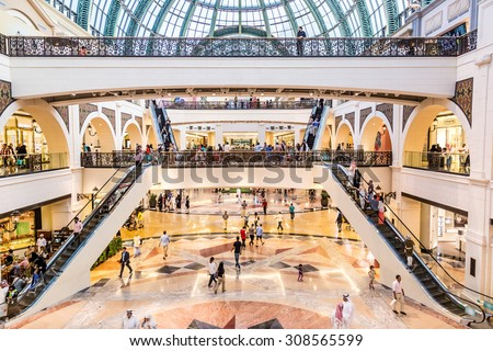 DUBAI, UAE - APRIL 29: Shoppers at Mall of the Emirates on April 29, 2013 in Dubai. Mall of the Emirates is a shopping mall in the Al Barsha district of Dubai. - stock photo