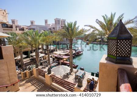 DUBAI, UAE - APRIL 11: View of the Souk Madinat Jumeirah.Madinat Jumeirah encompasses hotels and  traditional Arabic architecture. April 11, 2016 in Dubai - stock photo