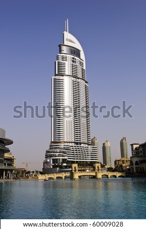 DUBAI, UAE - AUG 03: The Address Hotel in the downtown Dubai area overlooks the famous dancing fountains, taken on 3rd August 2010 in Dubai. The hotel is surrounded by a mall, hotels and Burj Khalifa - stock photo