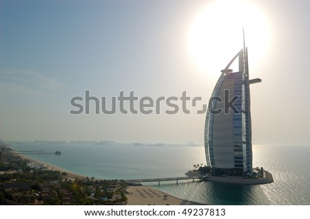 "DUBAI, UAE - AUGUST 27: The world's first seven stars luxury hotel Burj Al Arab ""Tower of the Arabs"", also known as ""Arab Sail"" at sunset  on August 27, 2009 in Dubai, United Arab Emirates - stock photo"