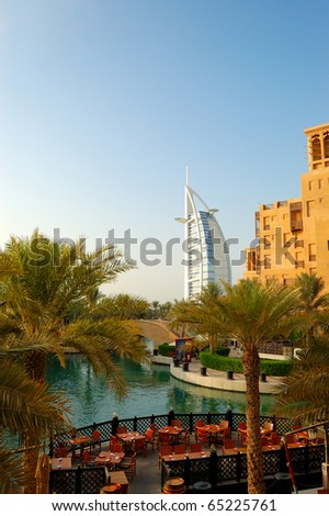 """DUBAI, UAE - AUGUST 27: The world's first seven stars luxury hotel Burj Al Arab """"Tower of the Arabs"""", also known as """"Arab Sail"""" at sunset on August 27, 2009 in Dubai, United Arab Emirates - stock photo"""