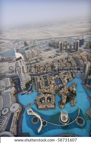 DUBAI, UAE - AUGUST 03: View from the 124th floor of the Burj Khalifa in Dubai on Aug 3rd 2010.  The observation deck has reopened after closure for maintenance earlier in the year. - stock photo
