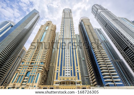 DUBAI, UAE - AUGUST 14 View of modern skyscrapers in Dubai Marina on AUGUST 14, 2013 in Dubai, UAE. Dubai Marina - artificial canal city, carved along a 3 km stretch of Persian Gulf shoreline. - stock photo