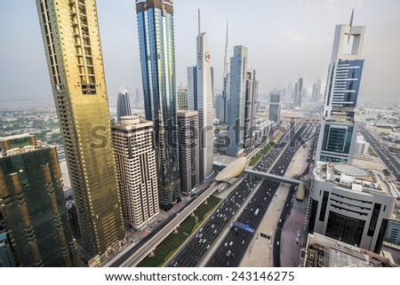 DUBAI, UAE - AUGUST 16: View of Sheikh Zayed Road skyscrapers in Dubai, UAE on AUGUST 16, 2013. More than 25 skyscrapers can be found here. - stock photo