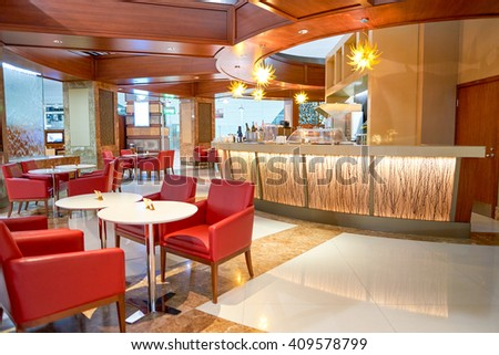 DUBAI, UAE - CIRCA APRIL, 2016: interior of Emirates business class lounge. Emirates is the largest airline in the Middle East. It is an airline based in Dubai, United Arab Emirates. - stock photo