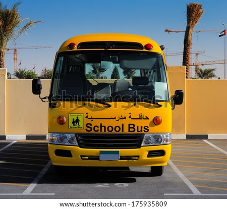 DUBAI, UAE - DEC 13: A front on view of a yellow Arabic school bus on Dec 13, 2013 in Dubai, UAE. - stock photo