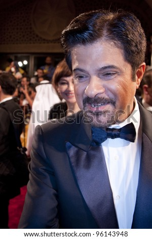 "DUBAI, UAE - DEC 7: Anil Kapoor greets fans as he arrives at the opening ceremony for ""Mission Impossible"" World Premiere during the 8th Dubai International Film Festival on Dec 7, 2011 in Dubai, UAE"