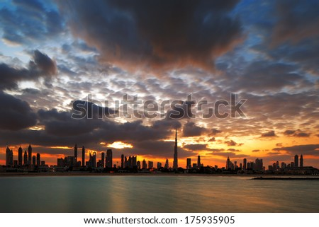 DUBAI, UAE - DEC 17: Graphic clouds combined with strong wind to create a dynamic skyline at dawn on Dec 17, 2013 in Dubai, UAE. - stock photo