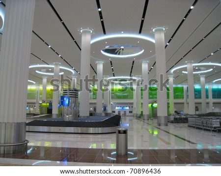 DUBAI, UAE - DEC 19: The new Emirates Terminal in Dubai International Airport on December 19, 2008 in Dubai, UAE. The maximum throughput of the airport is 80 million passengers in a year. - stock photo