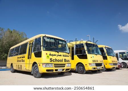 DUBAI, UAE - DEC 18: Yellow School Buses in the parking lot in Dubai. December 18, 2014 in Dubai, United Arab Emirates - stock photo