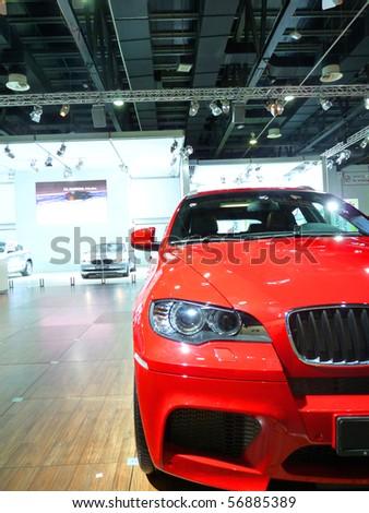 DUBAI, UAE - DECEMBER 19: BMW Red Vehicle on display during Dubai Motor Show 2009 at Dubai Int'l Convention and Exhibition Centre December 19, 2009 in Dubai, United Arab Emirates. - stock photo