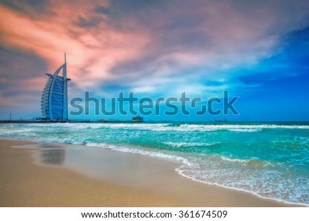 DUBAI, UAE - DECEMBER 6: Burj Al Arab hotel on Dec 6, 2015 in Dubai. Burj Al Arab is a luxury 5 stars hotel built on an artificial island in front of Jumeirah beach. - stock photo