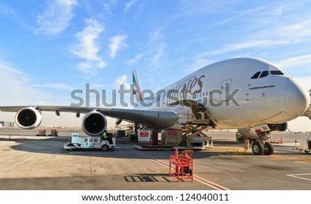DUBAI, UAE - DECEMBER 26: Emirates Airbus A380 at Dubai Airport on December 26, 2012 in Dubai, UAE. Emirates was first customer to place order for the a380. - stock photo