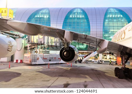 DUBAI, UAE - DECEMBER 26: Emirates Airbus A380 at Dubai Airport on December 26, 2012 in Dubai, UAE. Emirates handles major part of passenger traffic and aircraft movements at the airport. - stock photo