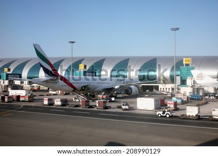 DUBAI, UAE - DECEMBER 09: Emirates Airbus A320 at Dubai Airport on December 09, 2012 in Dubai, UAE. Emirates handles major part of passenger traffic and aircraft movements at the airport. - stock photo