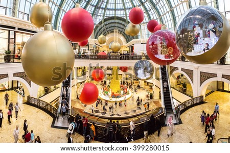 DUBAI, UAE - DECEMBER 31: Shoppers at Mall of the Emirates decorated for christmas holiday  in Dubai on December 31, 2015 - stock photo