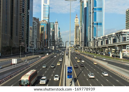 DUBAI, UAE - DECEMBER 23: The development of the Sheikh Zayed Road on December 23, 2013 in Dubai, UAE. Dubai was the fastest developing city in the world between 2002 and 2008  - stock photo